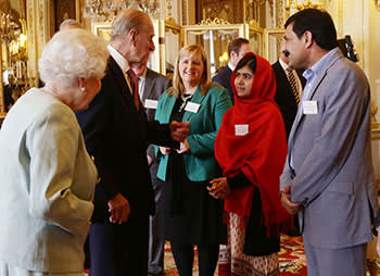 Malala and her father, Ziauddin, at a Buckingham Palace reception with the Queen on October 18 2013