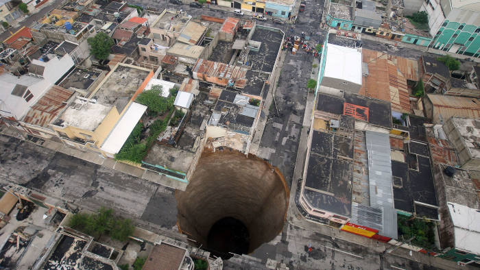 A giant sinkhole caused by the rains of Tropical Storm Agatha is seen in Guatemala City May 31, 2010