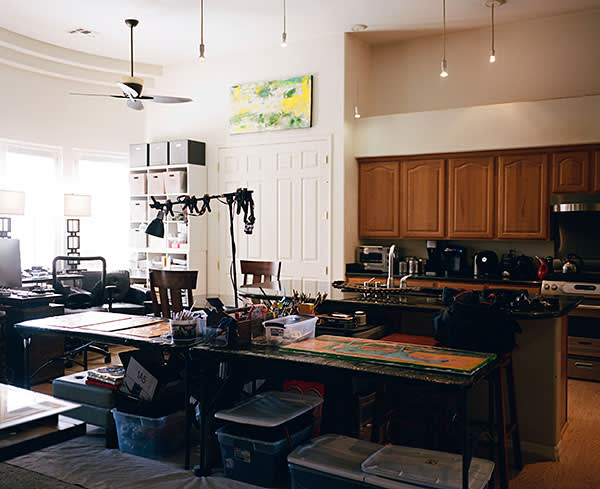 The family kitchen and living space, with some of Autumn's paintings