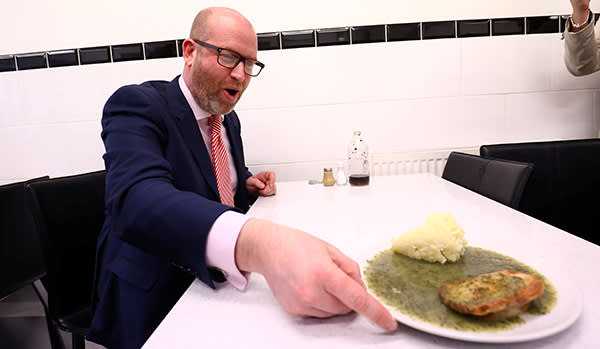 UKIP leader Paul Nuttall poses with pie and mash during a campaign event in Elm Park, Britain May 20, 2017. REUTERS/Neil Hall - RTX36PSV