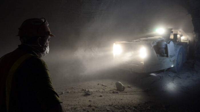A miner works at the Cullinan Diamond Mine, 100 kms north-east of Johannesburg, on October 10, 2013 in Cullinan