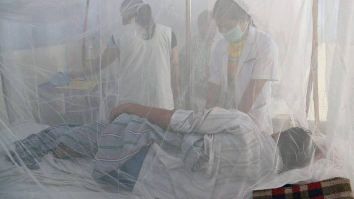 Indian medical staff examine dengue patients in beds covered with a mosquito net in the dengue ward of a civil hospital in Amritsar on September 19, 2015. Dengue fever, a mosquito-born disease with no known cure or vaccine, strikes fear into citizens of northern India when it arrives with the monsoon rains. AFP PHOTO/ NARINDER NANU        (Photo credit should read NARINDER NANU/AFP/Getty Images)
