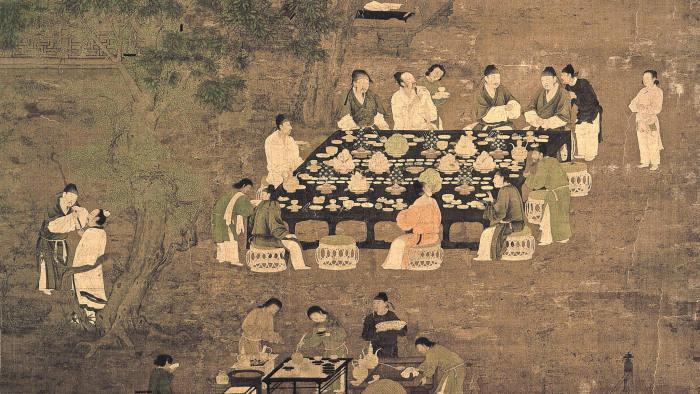 'Scholars meeting in a garden'