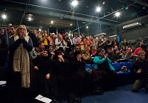 The audience applauds after the performance