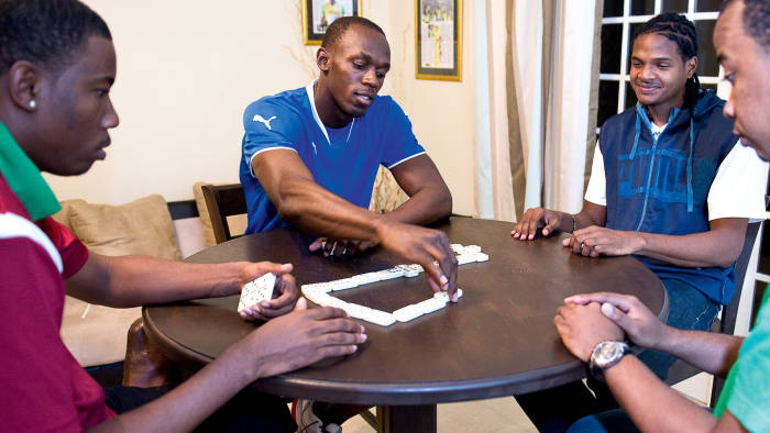 Usain Bolt playing dominoes