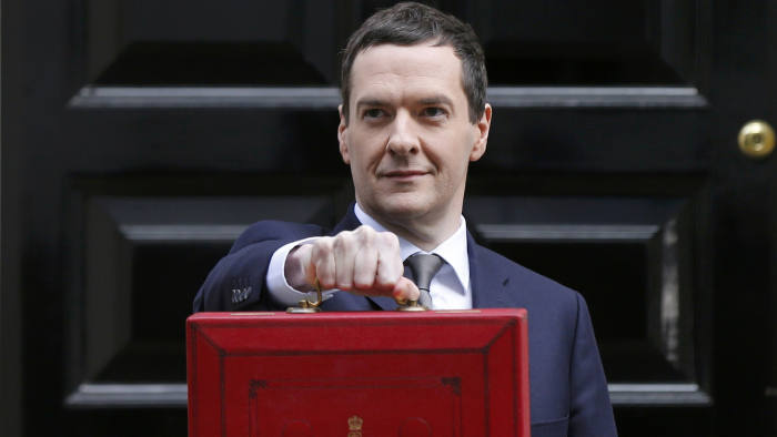 Britain's Chancellor of the Exchequer, George Osborne, holds up his budget case for the cameras as he stands outside number 11 Downing Street, before delivering his budget to the House of Commons, in central London March 18, 2015. REUTERS/Suzanne Plunkett (BRITAIN - Tags: BUSINESS POLITICS)