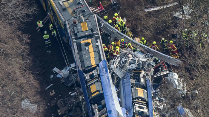 Aerial view shows firefighters and emergency doctors working at the site of a train accident near Bad Aibling, southern Germany, on February 9, 2016.