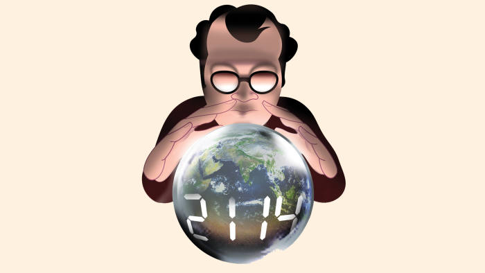 A man wearing glasses looking at a globe