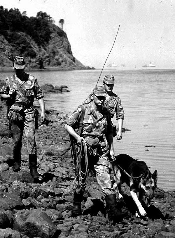 KURIL ISLANDS, RUSSIA - SEPTEMBER 6: Soldiers of the Russian frontier guard carry out routine beach patrol on one of the Kuril Islands, Russia 06 September, 1992. These disputed islands, north of Hokkaido, Japan, will come under the microscope early next week when Russian President Boris Yeltsin visits Japan to discuss the status of the islands which have been occupied by the former USSR since the end of the Second World War. (Photo credit should read Vareriy KISELEV/AFP/Getty Images)