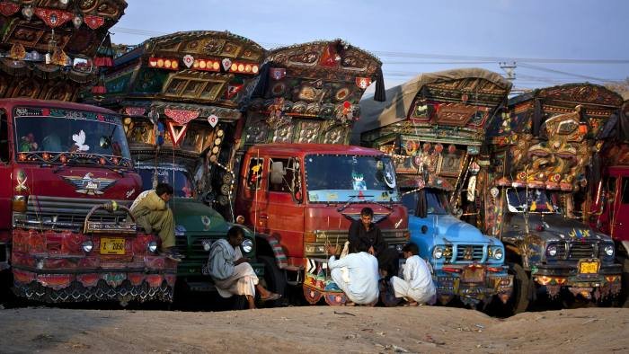Pakistani truck drivers chat during their free time at a terminal on the outskirts of Islamabad, Pakistan, Sunday, April 15, 2012. (AP Photo/Anjum Naveed)