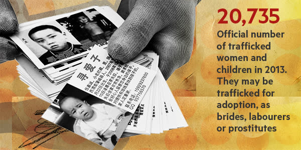 Cards showing the faces of missing children are handed out by desperate parents