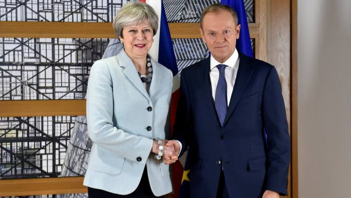 Britain's Prime Minister Theresa May poses for a picture with European Council President Donald Tusk ahead of a meeting at the European Council in Brussels, Belgium, December 8, 2017. REUTERS/Eric Vidal