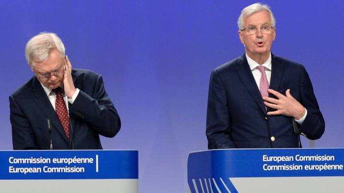 British Secretary of State for Exiting the European Union (Brexit Minister) David Davis (L) listens to European Union Chief Negotiator in charge of Brexit negotiations with Britain Michel Barnier (R) as he addresses media representatives during a press conference at The European Union Commission Headquarters in Brussels on July 20, 2017. / AFP PHOTO / THIERRY CHARLIERTHIERRY CHARLIER/AFP/Getty Images