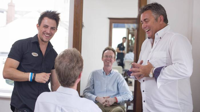 Name recognition: Andrew Hill, management columnist, centre, in the salon of hairdresser Andrew Hill, right