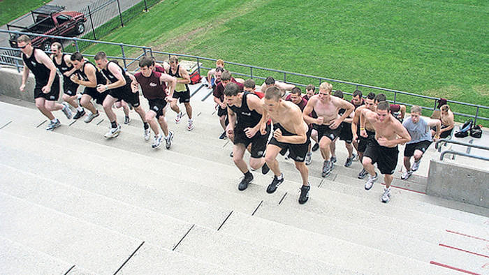 Initiation: new recruits to the Gentle Giant removals company in Massachusetts are put to the test in Harvard stadium