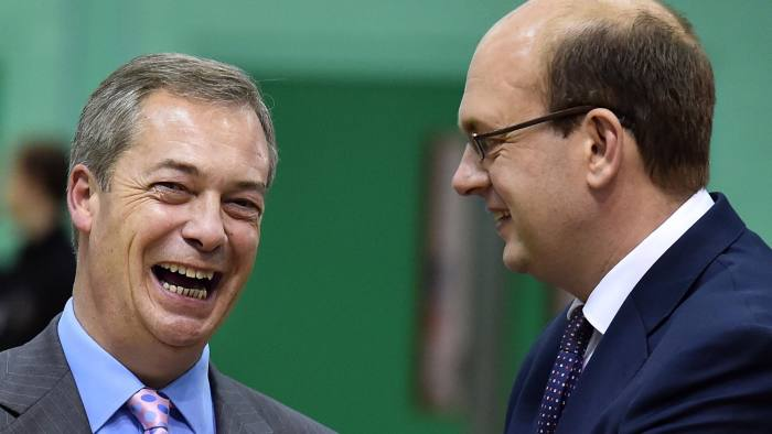 UK Independence Party (UKIP) party leader Nigel Farage (L) and UK Independence Party (UKIP) parliamentary candidate Mark Reckless (R) speak before the by-election announcement in Rochester, Kent on November 21, 2014. Britain's anti-European Union UK Independence Party (UKIP) claimed a second seat in parliament in the town of Rochester, foreshadowing a possible political upheaval in next year's general election. AFP PHOTO / BEN STANSALL AFP PHOTO / BEN STANSALL (Photo credit should read BEN STANSALL/AFP/Getty Images)