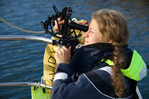 Another crew member getting to grips with a sextant