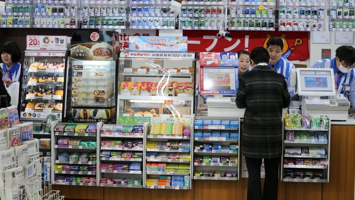 KOBE, JAPAN - JANUARY 27: A customer purchases some items at a newly designed train-shaped convenience store named Lawson + Friends on its opening day at the Itayado station on January 27, 2016 in Kobe, Japan. The train-shaped convenience store, jointly developed by franchise operators Lawson Inc. and Sanyo Friends KK, was newly opened on January 27, 2016 at Sanyo Electric Railway Co.'s Itayado Station. (Photo by Buddhika Weerasinghe/Getty Images)