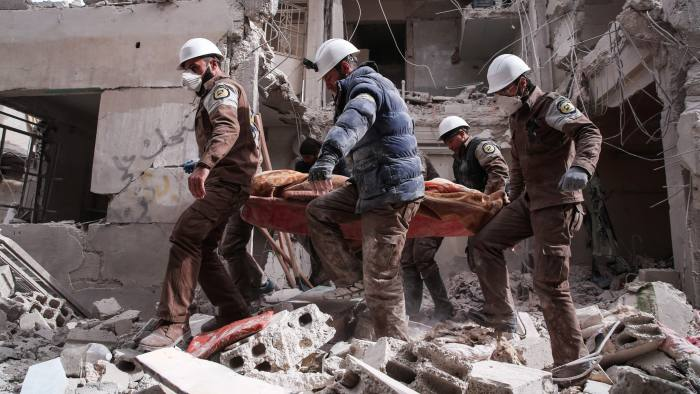 Syrian civil defence volunteers, known as the White Helmets, search for survivors following reported government airstrike on the rebel-held neighbourhood of Tishrin, on the northeastern outskirts of the capital Damascus, on February 22, 2017. / AFP PHOTO / Msallam ABDALBASETMSALLAM ABDALBASET/AFP/Getty Images