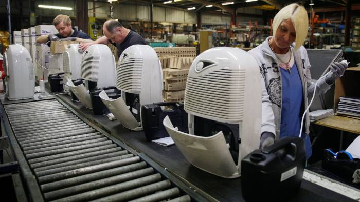Employees assemble dehumidifiers on the production line at the Ebac Ltd. factory in Newton Aycliffe, U.K., on Monday, Jan. 9, 2017. The pound has weakened by more than 10 percent versus the euro since the referendum, making Ebac's water coolers and dehumidifiers cheaper abroad. Photographer: Matthew Lloyd/Bloomberg