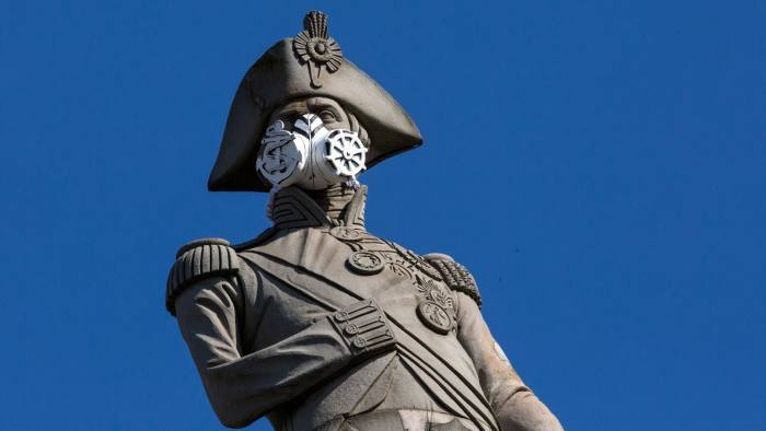 LONDON, ENGLAND - APRIL 18: A face mask is placed on the statue of Nelson's Column by Greenpeace protesters on April 18, 2016 in London, England. The demonstration was to highlight air pollution in Britain and targeted other statues in the city including Queen Victoria opposite Buckingham Palacea and Eros at Piccadilly Circus. (Photo by Dan Kitwood/Getty Images)