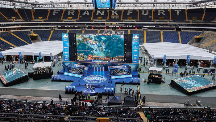 The stage at Frankfurt's Commerzbank-Arena, with the two competing e-sports teams flanked by booths for the commentators and analysts
