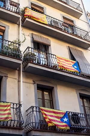 The Catalan independence flag hangs from balconies in Barcelona's Gràcia district
