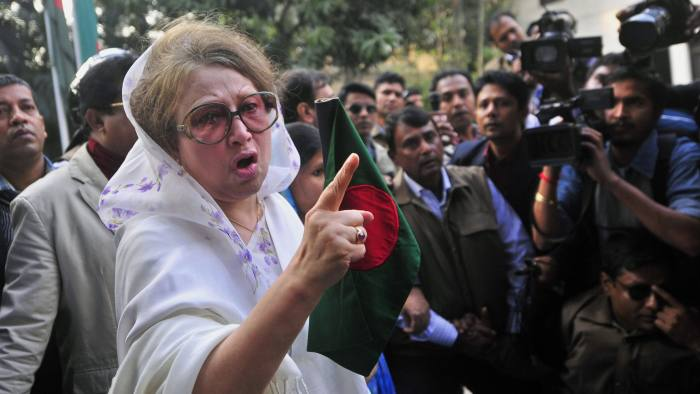 Khaleda Zia...Bangladesh's former Prime Minister and main opposition Bangladesh Nationalist Party (BNP) leader Khaleda Zia gestures as she walks out of her home in Dhaka, Bangladesh, Sunday, Dec. 29, 2013. Security forces and opposition activists clashed in Bangladesh's capital on Sunday, leaving at least one person dead, as thousands of police took to the streets to foil a mass rally calling on Prime Minister Sheikh Hasina to cancel upcoming elections. (AP Photo/Khurshed Rinku)