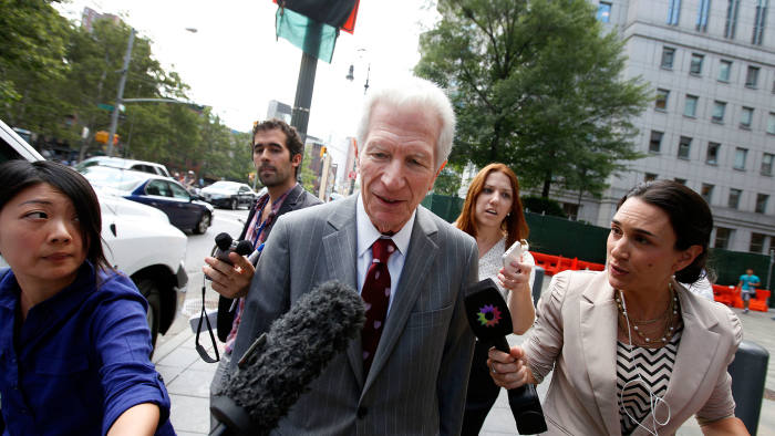 Mediator Daniel Pollack, center, leaves federal court after a hearing regarding Argentina's request to extend deadlines to repay a $1.65 billion debt to US hedge funds, Friday, June 27, 2014, in New York.