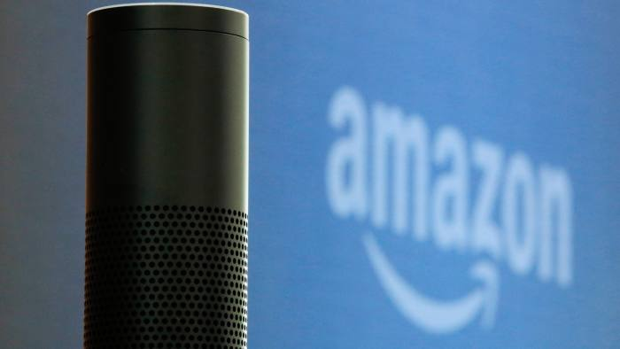 """An """"Echo"""" device stands on display during the U.K. launch event for the Amazon.com Inc. Echo voice-controlled home assistant speaker in London, U.K., on Wednesday, Sept. 14, 2016. The Seattle-based company today announced that its Echo product line will be available in the U.K. and Germany starting in the fall, the first time the gadget will be available outside the U.S. Photographer: Luke MacGregor/Bloomberg"""