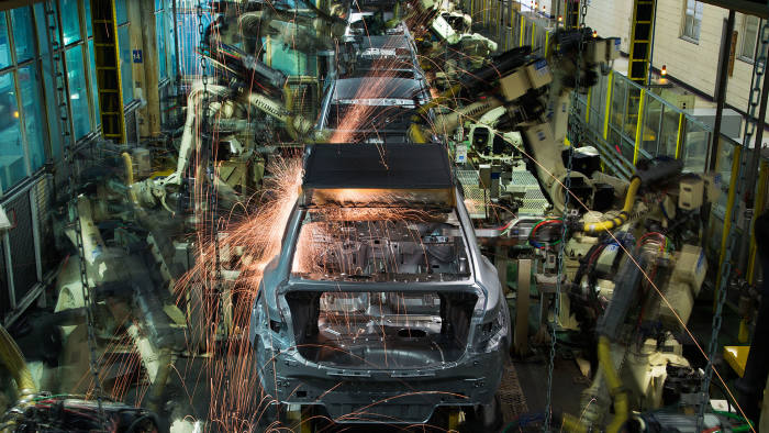 Robots weld Hyundai Motor Co. vehicle frames on the production line at the company's factory in Asan, South Korea, on Tuesday, Jan. 20, 2015
