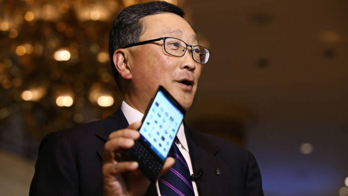 John Chen, chief executive officer of BlackBerry Ltd., holds the BlackBerry Priv smartphone as he speaks during a Bloomberg Television interview at the Asia-Pacific Economic Cooperation (APEC) CEO Summit in Manila, the Philippines, on Tuesday, Nov. 17, 2015. BlackBerry needs to sell five million phones a year before it can start making money, Chen said. Photographer: SeongJoon Cho/Bloomberg *** Local Caption *** John Chen