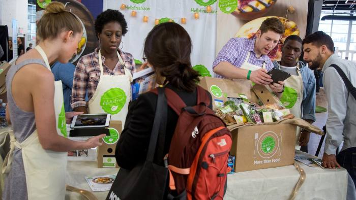 HelloFresh representatives sign up attendees with discounts for the company's meal delivery service during the Northside Innovation Expo at the Brooklyn Expo Center in the Brooklyn borough of New York, U.S., on Thursday, June 9, 2016. First-time jobless claims unexpectedly fell last week and the number of Americans already receiving benefits tumbled to an almost 16-year low, consistent with a healthy labor market. Photographer: Michael Nagle/Bloomberg
