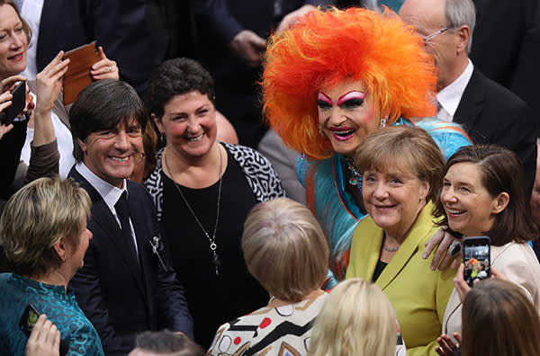 BERLIN, GERMANY - FEBRUARY 12: German Chancellor Angela Merkel (R), drag queen Olivia Jones and German football coach Joachim Loew (L) attend the election of the new president of Germany by the Federal Assembly at the Reichstag on February 12, 2017 in Berlin, Germany. Frank-Walter Steinmeier, a German Social Democrat (SPD), is Germany's former foreign minister and is likely to win. He will succeed outgoing German president Joachim Gauck. (Photo by Sean Gallup/Getty Images)