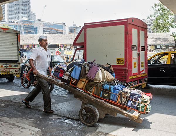 Kedari pushes his cart against the traffic