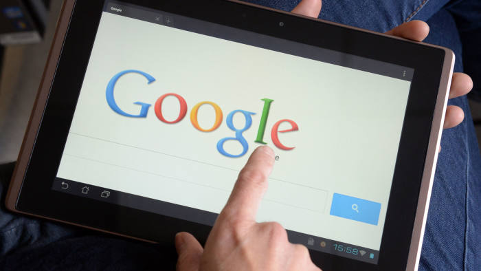 A woman uses Google's search engine on her tablet
