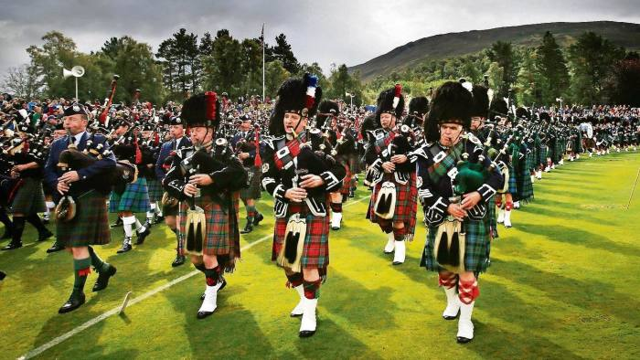 The Massed Pipes and Drums during the Braemar Royal Highland Gathering in Braemar, Scotland