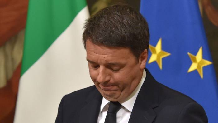 """Italy's Prime Minister Matteo Renzi announces his resignation during a press conference at the Palazzo Chigi following the results of the vote for a referendum on constitutional reforms, on December 4, 2016 in Rome. """"My experience of government finishes here,"""" Renzi told a press conference after the No campaign won what he described as an """"extraordinarily clear"""" victory in the referendum on which he had staked his future. / AFP PHOTO / Andreas SOLAROANDREAS SOLARO/AFP/Getty Images"""