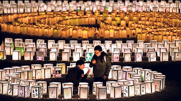 Thousands of lanterns are lit up to mourn for the victims of the March 11, 2011 earthquake and tsunami in Natori, Miyagi Prefecture, in this photo taken by Kyodo March 8, 2015