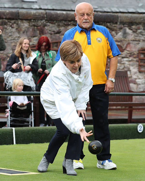 PABEST First Minister and SNP leader Nicola Sturgeon throws a bowl watched by John Thorburn during a visit to the Liberton Bowling Club in Edinburgh South as part of the party's General Election campaign trail. PRESS ASSOCIATION Photo. Picture date: Saturday May 20, 2017. See PA story ELECTION Scotland. Photo credit should read: Andrew Milligan/PA Wire