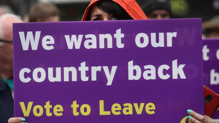 BOLTON, ENGLAND - MAY 25: A Vote to Leave campaigner holds a placard as Leader of the United Kingdom Independence Party (UKIP), Nigel Farage campaigns for votes to leave the European Union in the referendum on May 25, 2016 in Bolton, England. Nigel Farage took his battle bus to Bolton encouraging British people to vote to leave the EU on 23rd June 2016. (Photo by Christopher Furlong/Getty Images)