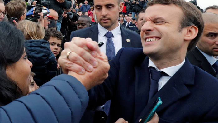 French presidential election candidate Emmanuel Macron, head of the political movement En Marche !, or Onwards ! greets supporters as leaves a polling station during the the second round of 2017 French presidential election, in Le Touquet, France, May 7, 2017. REUTERS/Philippe Wojazer TPX IMAGES OF THE DAY