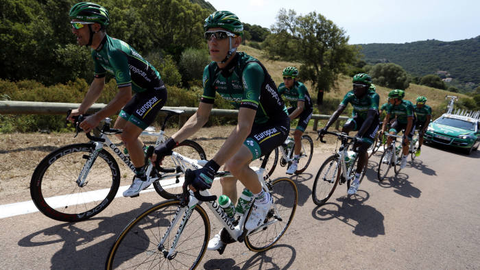France's Pierre Roland (R) rides with his Europcar's teammates during a training session on June 27 2013 in Porto-Vecchio on the French island of Corsica