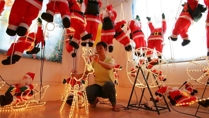 A Chinese laborer produces Christmas decorations at the Fly Ocean Toys factory on the outskirts of Guangzhou, south China's Guangdong province