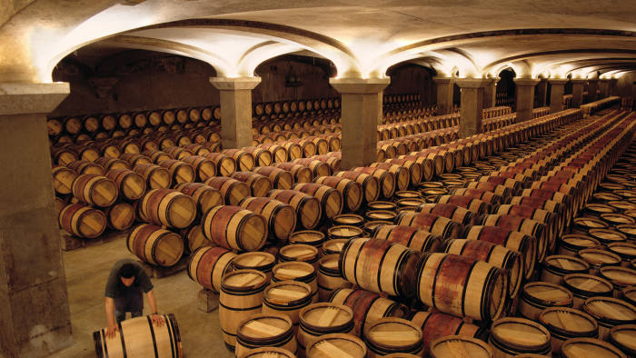 Rolling a barrel into the 2nd year chai of Chateau Margaux Margaux Gironde France Bordeaux