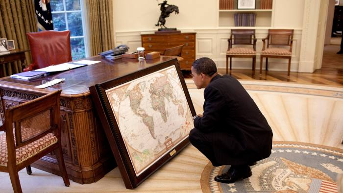 President Barack Obama...WASHINGTON - JUNE 10: In this handout image provided by The White House, President Barack Obama looks at a map donated to the White House by the National Geographic Society June 10, 2009 in Washington, DC. (Photo by Pete Souza/The White House via Getty Images)