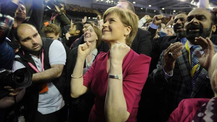 Leader of the Scottish National Party (SNP), Nicola Sturgeon (C) celebrates as election results are announced at the Glasgow election count at the Emirates Arena in Glasgow on May 8, 2015, after the polls closed in the British general election. Scottish nationalists were headed for sweeping gains in Britain's general election on Thursday, with an exit poll indicating a surge in support that could increase pressure for a new independence referendum. AFP PHOTO / ANDY BUCHANANAndy Buchanan/AFP/Getty Images