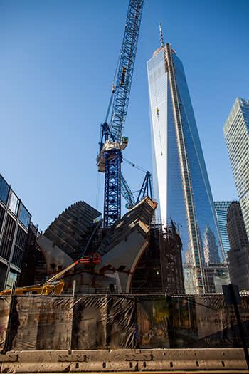 Construction work continues on Calatrava's 'ribcage' roof in the shadow of the 1,776ft-high 1WTC tower