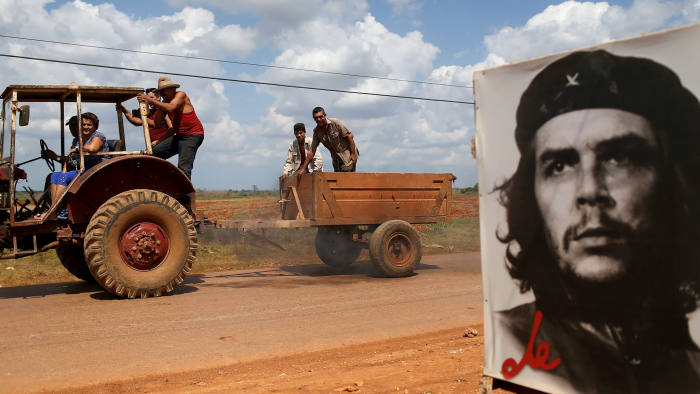 GABRIEL, CUBA - FEBRUARY 28: A poster of Revolutionary hero Che Guevara is seen next to the road a day after the second round of diplomatic talks between the United States and Cuban officials took place in Washington, DC on February 28, 2015 in Gabriel, Cuba. The dialogue is an effort to restore full diplomatic relations and move toward opening trade. (Photo by Joe Raedle/Getty Images)