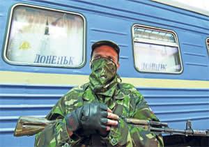 An armed pro-Russian separatist stands guard at a railway station in Donetsk...An armed pro-Russian separatist stands guard at a railway station in Donetsk July 21, 2014. REUTERS/Konstantin Cherginsky (UKRAINE - Tags: POLITICS CIVIL UNREST TRANSPORT)